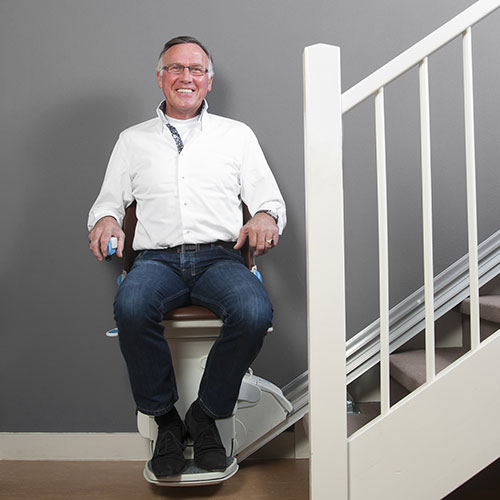 Man siting on Simplicity model stairlift