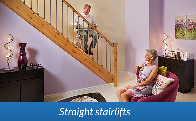 Stairlift with man seated on straight staircase